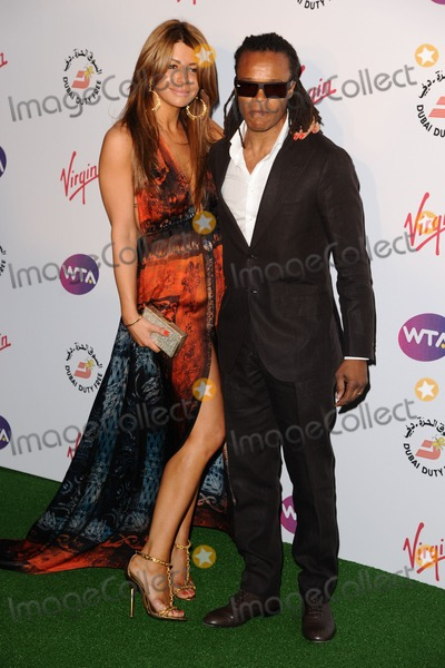 Olcay Gulsen, Edgar Davids Photo - Edgar Davids and fiance, Olcay Gulsen arriving for the 2012 WTA Pre-Wimbledon Party at the Roof Gardens in Kensington, London. 21/06/2012 Picture by: Steve Vas / Featureflash