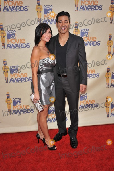 Mario Lopez, Courtney Mazza Photo - Courtney Laine Mazza & Mario Lopez at the 2009 MTV Movie Awards at Universal Studios Hollywood.