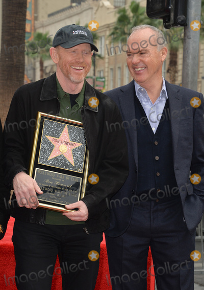 Michael Keaton, Ron Howard, Michael Bublé, Michael Paré Photo - Director Ron Howard & actor Michael Keaton on Hollywood Boulevard where he was honored with the 2,568th star on the Hollywood Walk of Fame. It is his second star, his first was awarded for his TV work in 1981.December 10, 2015  Los Angeles, CAPicture: Paul Smith / Featureflash
