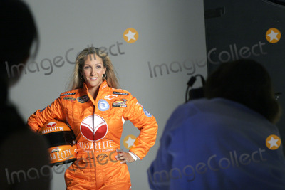 Kim Crosby, NASCAR DRIVERS, Photo Shoot Photo - Female Nascar driver Kim Crosby during a photo shoot with her new sponsor Vassarette Lingerie's new driving suit August 23, 2005 in New York City.
