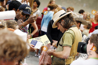 """Big and Rich, Big Kenny, Big Kenny Alphin, Kenny Alphin, """"Big Kenny"""" Alphin Photo - Big Kenny Alphin of the country duo Big And Rich signs autographs during The Today Show on July 8, 2006 in"""