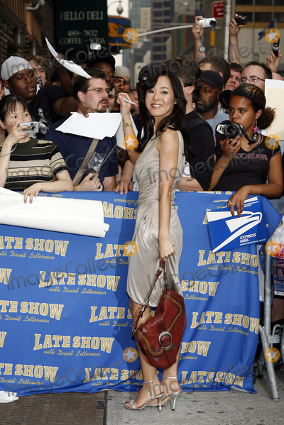 David Letterman, Yunjin Kim Photo - Yunjin Kim signs autographs outside The Late Show With David Letterman on July 11, 2006 in New York City.
