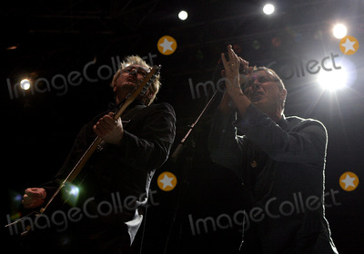 """Andy Gill, Andy King, Gang of Four, Jon King, Coney Island, King Sunny Adé Photo - Gang Of Four's guitarist Andy Gill (L) and lead singer Jon King onstage performing during the """"Across The Narrows"""" concert at Keyspan Park in Coney Island on            October 1  , 2005 in New York City."""