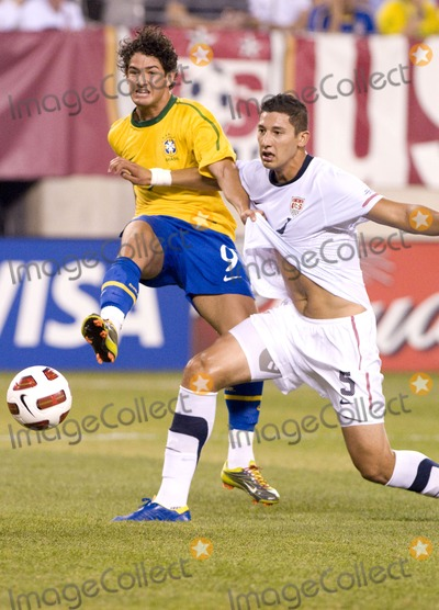 The Used, Omar Gonzalez, Alexandre Pato Photo - Brazil forward Alexandre Pato (L) shoots on goal while US defender Omar Gonzalez (R) tries to stop him during the US vs. Brazil game at the New Meadowlands Stadium on August 10, 2010 in East Rutherford, New Jersey.