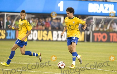 The Used, Alexandre Pato Photo - Brazil forwards Neymar (L) and Alexandre Pato (R) pictured on the attack during the US vs. Brazil game at the New Meadowlands Stadium on August 10, 2010 in East Rutherford, New Jersey.