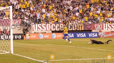 The Used, Tim Howard, Alexandre Pato Photo - Brazil forward Alexandre Pato (#9) watches his shot after dribbling past US goalkeeper Tim Howard (#1)  during the US vs. Brazil game at the New Meadowlands Stadium on August 10, 2010 in East Rutherford, New Jersey.