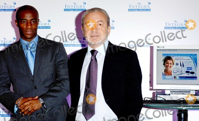 """Alan Sugar, Sir Alan Sugar, Tim Campbell Photo - London. Sir Alan Sugar and Tim Campbell (stars of BBC 2's """"The Apprentice"""" and winner of the first series)attend the launch of Amstrad's `latest innovation in the health and beauty industry-INTEGRA at Energy Clinic on Commercial Street.20 September 2005.Ali Kadinsky/Landmark Media"""