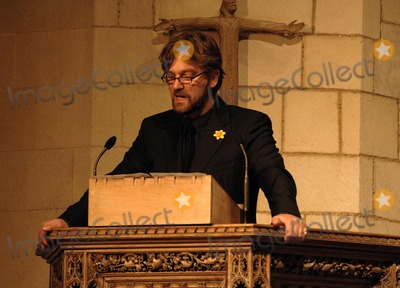 Photo - London.  Simon Shepherd reads a poem at the Marie Curie Cancer Care Christmas Concert held in Southwark Cathedral 13 December 2006Ali Kadinsky/Landmark Media