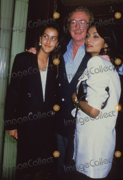 Michael Cain, Michael Caine, Natasha Caine, Shakira, Shakira Caine Photo - London, UK. LIBRARY. Michael Caine with wife Shakira Caine (right) and daughter Natasha Caine. Mid 1990s. ReCap:10.07.2020