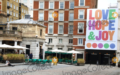 Covent Garden Photo - London, UK.   A giant four storey tall outdoor art installation, with the words of Love, Hope & Joy emblazoned across a building overlooking the Covent Garden Piazza, welcoming Londoners back to the city after the Covid-19 lockdown. Typography Artist Anthony Burrill was commissioned by Covent Garden. 3rd July 2020. Ref:LMK73-S3050-050720Keith Mayhew/Landmark Media WWW.LMKMEDIA.COM.