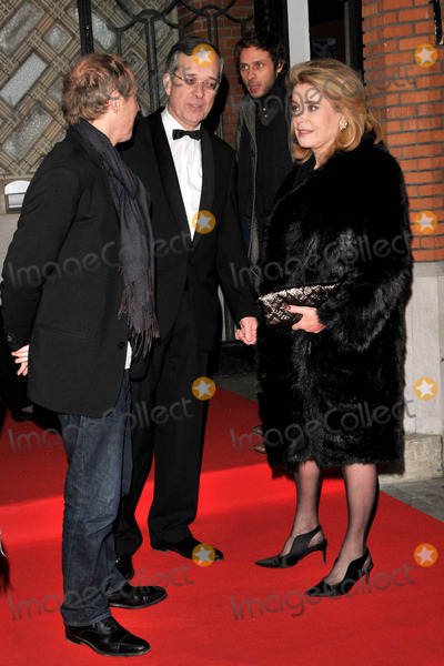 Arnaud Desplechin, Catherine Deneuve, Queensberry Photo - London, UK . French film director Arnaud Desplechin (L)  and Catherine Deneuve with the French ambassador Maurice Gourdault-Montagne  (C) at the  Cine Lumiere Gala Opening at the Institut Francais at 17 Queensberry, South Kensington, London. 9th January 2008. Syd/Landmark Media.
