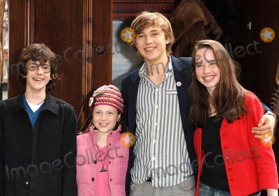 Anna Popplewell, Georgi, Georgie Henley, Pink, Skandar Keynes, William Moseley, Leicester Square Photo - London. The children from The Chronicles of Narnia, (Skandar Keynes -blue jumper, Georgie Henley - pink jacket, William Moseley - striped shirt and Anna Popplewell - red jacket) attends the launch of the 10th Anniversary of National Schools Film Week, at the Odeon Leicester Square.12 October 2005Ali Kadinsky/Landmark Media