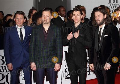 Arctic Monkeys, The Arctic Monkeys Photo - London. UK. The Arctic Monkeys  at the The BRIT Awards with MasterCard 2014 Red Carpet arrivals at the 02 Arena, London. 19th February 2014 . Ref:LMK73-47701-200214Keith Mayhew/Landmark MediaWWW.LMKMEDIA.COM.