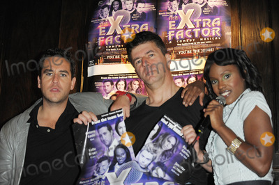 Anthony Kavanagh, Kelle Bryan, Simon Cowell Photo - London, UK.  Anthony Kavanagh, Andrew Monk (Simon Cowell lookalike),and Kelle Bryan posing at a photocall for The eXtra Factor, a new interactive comedy musical at `Salvador & Amanda' in central London.  21 August 2008.