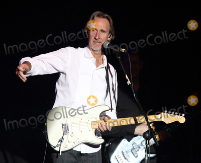 Mike Rutherford, Genesis, Tim Howar, Andrew Roachford Photo - St Albans, UK. Mike and the Mechanics - formed by Genesis guitarist Mike Rutherford and also featuring lead singer Tim Howar and on keyboards and lead vocals Andrew Roachford play live at the Alban Arena, St Albans, Hertfordshire on March 9th 2014.Ref: LMK73-44847-100314Keith Mayhew/Landmark Media. WWW.LMKMEDIA.COM.