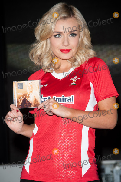Katherine Jenkins, The Team Photo - London. UK . Welsh singer Katherine Jenkins at a signing session for her new album 'Daydream' at HMV Oxford St, London, UK on 14th October 2011. Jenkins is wearing a Welsh rugby jersey in support of the team who play in the World Cup Semi Finals against France.  . Justin Ng/Landmark Media