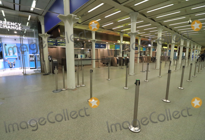 Photo - London, UK. London St Pancras International station.Large empty spaces where tourists usually gather and deserted streets around landmarks due to the threat of a further spread of coronavirus -COVID-19  . London 19th March 2020Ref: LMK73-J6378-200320Keith Mayhew/Landmark MediaWWW.LMKMEDIA.COM
