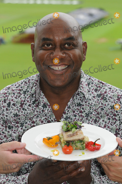 Ainsley Harriott, Alec Stewart, ASH Photo - London. UK.  Ainsley Harriott (chef), Alec Stewart (former England cricket captain and now BBC cricket commentator) and Chris Garrett (Oval cricket ground head chef), take part in a 'cook-off' to promote food available during the upcoming and final Ashes test match of this series held at the Oval Surrey County Cricket Club in Kennington.
