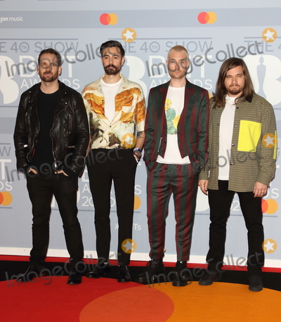 Photo - London, UK. Bastille at 40th Brit Awards Red Carpet arrivals, The O2 Arena, London on February 18th 2020.