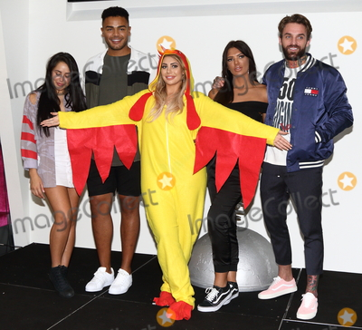 Geordie, Marnie Simpson, Chloe Ferry, Abbie Holborn, Nathan Henry, Aaron Chalmers, Gianfranco Ferrè, Gianfranco Ferré Photo - London.UK. Abbie Holborn, Chloe Ferry and Marnie Simpson, Nathan Henry and Aaron Chalmers    at The Launch of the new series of Geordie Shore at MTV Studios, followed by Chloe Ferry dressing up as a chicken to celebrate world record for eating chicken nuggets in Camden, London, UK on the 29th August 2017.  Ref:LMK73-S626-300817Keith Mayhew/Landmark MediaWWW.LMKMEDIA.COM