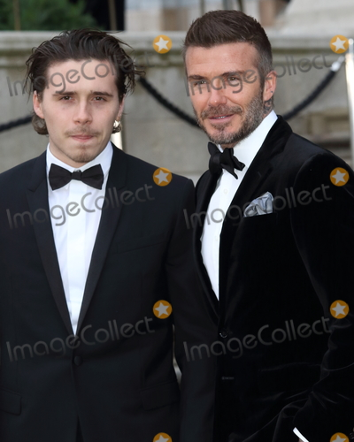 Brooklyn Beckham, David Beckham Photo - London, UK. Brooklyn Beckham and David Beckham at World Premiere of Netflix's Our Planet at the Natural History Museum, Kensington, London on April 4th 2019.