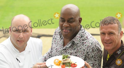 Ainsley Harriott, Alec Stewart, ASH Photo - London. UK.  Ainsley Harriott (chef), Alec Stewart (former England cricket captain and now BBC cricket commentator) and Chris Garrett (Oval cricket ground head chef), take part in a 'cook-off' to promote food available during the upcoming and final Ashes test match of this series held at the Oval Surrey County Cricket Club in Kennington.12 August 09.Ali Kadinsky/Landmark Media