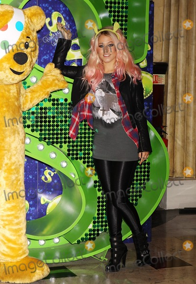 Pudsey Bear, Amelia Lily Photo - London, UK. X Factor finalist Amelia Lily joins Pudsey Bear at Shrek The Musical at  Theatre Royal Drury Lane  to celebrate her collaboration in this years BBC Children in Need POP Goes the Musical in London. 29th October 2012.J Adams/Landmark Media