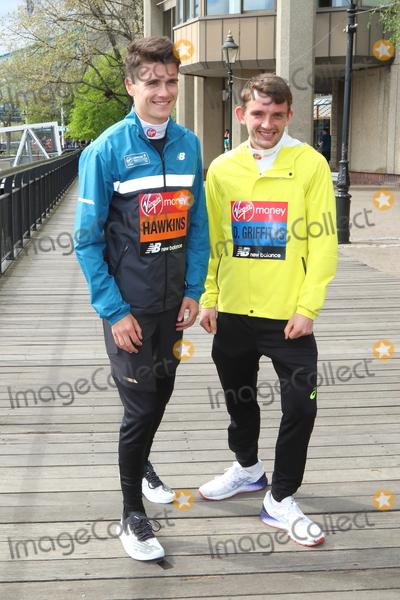 Callum Hawkins, Dewi Griffiths Photo - London, UK. Callum Hawkins, Dewi Griffiths at Elite Runners Photocall for the London Marathon 2019 outside the Tower Hotel Race HQ on April 24th 2019Ref: LMK73-4803-250419Keith Mayhew/Landmark MediaWWW.LMKMEDIA.COM