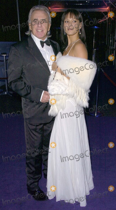 Peter Stringfellow, Peter André Photo - London. UK.  Peter Stringfellow and partner   at the  'La Dolce Vita' London Charity gala, Battersea Exhibition Centre, London. 12th December 2007. Can Nguyen/Landmark Media.