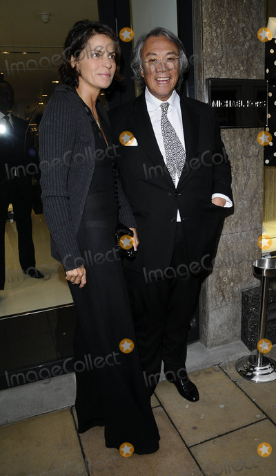 David Tang, Michael Kors Photo - London.UK. David Tang and his wife at the  Michael Kors flagship store launch party. Michael Kors Boutique. New Bond Street . 27th April 2009. 