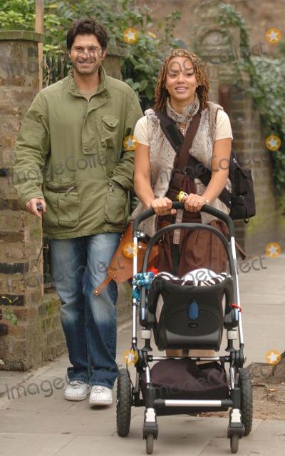 Angela Griffin Photo - London. Actress Angela Griffin and partner Jason Milligan with their baby girl Tallulah Jae walking in North London.10 December 2004Lee Scott/Landmark Media