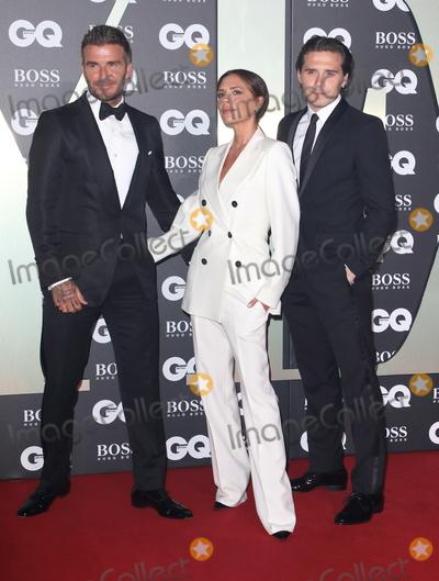 Brooklyn Beckham, David Beckham, Victoria Beckham Photo - London, UK. David Beckham, Victoria Beckham and Brooklyn Beckham at GQ Men of the Year Awards held at the Tate Modern, Bankside, London on September 3rd 2019.Ref: LMK73-J5391-040919Keith Mayhew/Landmark MediaWWW.LMKMEDIA.COM