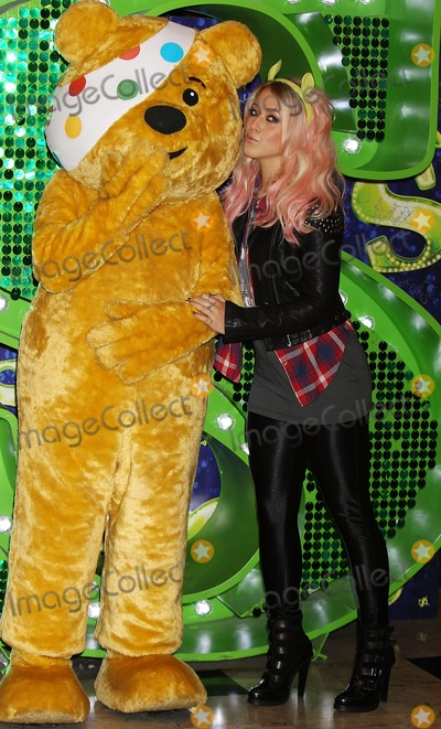 Pudsey Bear, Amelia Lily Photo - London, UK. X Factor finalist Amelia Lily joins Pudsey Bear at Shrek The Musical at  Theatre Royal Drury Lane  to celebrate her collaboration in this years BBC Children in Need POP Goes the Musical in London. 29th October 2012.