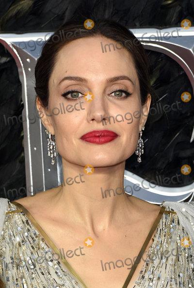 Angelina Jolie, ANGELINA JOLIE, Photo - London, UK. Angelina Jolie at Maleficent: Mistress Of Evil European Premiere held at BFI Imax, Waterloo on Wednesday  9 October 2019Ref: LMK392 -J5592-101019Vivienne Vincent/Landmark Media. WWW.LMKMEDIA.COM.