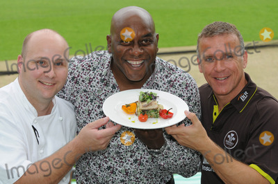 Ainsley Harriott, Alec Stewart, ASH Photo - London. UK.  Ainsley Harriott (chef), Alec Stewart (former England cricket captain and now BBC cricket commentator) and Chris Garrett (Oval cricket ground head chef), take part in a 'cook-off' to promote food available during the upcoming and final Ashes test match of this series held at the Oval Surrey County Cricket Club in Kennington.12 August 09.Matt Lewis/Landmark Media