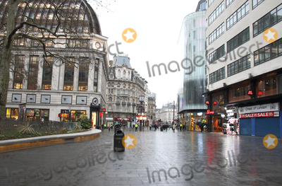 Leicester Square Photo - London, UK. Leicester Square. Large empty spaces where tourists usually gather and deserted streets around landmarks due to the threat of a further spread of coronavirus -COVID-19  . London 19th March 2020Ref: LMK73-J6378-200320Keith Mayhew/Landmark MediaWWW.LMKMEDIA.COM