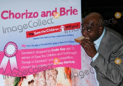 Ainsley Harriott, Train Photo - London. UK. Celebrity chef Ainsley Harriott  with the 11-year-old who designed the sandwich promoting a new range of charity sandwich, chorizo and brie. Sandwich will stocked across First Group's trains, London Paddington. 16th April 2009.Rafe Cook/Landmark Media
