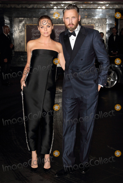 Alasdhair Willis, Stella McCartney Photo - London. UK. Stella McCartney and Alasdhair Willis   at the  British Fashion Awards.  Outside arrivals at the Savoy Hotel, The Strand, London. 27th November 2012. 