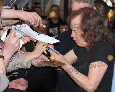 Angus Young, AC/DC Photo - London.UK. Angus Young of ACDC at the premiere of AC/DC 'Live at River Plate' DVD at the Hammersmith Apollo. London. 6th May 2011.Keith Mayhew/Landmark Media