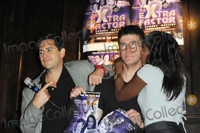Anthony Kavanagh, Kelle Bryan, Simon Cowell Photo - London, UK.  Anthony Kavanagh, Andrew Monk (Simon Cowell lookalike),and Kelle Bryan posing at a photocall for The eXtra Factor, a new interactive comedy musical at `Salvador & Amanda' in central London.  21 August 2008. Ali Kadinsky/Landmark Media