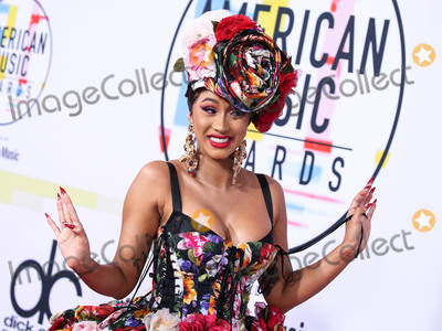 Dolce and Gabbana, Cardi B., Cardi B, Coronavirus Pandemic Photo - (FILE) Cardi B And Fashion Nova Are Giving Away $1,000 Per Hour Amid Coronavirus COVID-19 Pandemic. Fashion Nova and Cardi B are donating $1,000 every hour for the next 42 days until they've given away $1 million to those affected by the coronavirus pandemic. LOS ANGELES, CALIFORNIA, USA - OCTOBER 09: Rapper Cardi B (Belcalis Marlenis Almanzar) wearing a Dolce and Gabbana dress, styled by Kollin Carter arrives at the 2018 American Music Awards held at the Microsoft Theatre L.A. Live on October 9, 2018 in Los Angeles, California, United States. (Photo by Xavier Collin/Image Press Agency)
