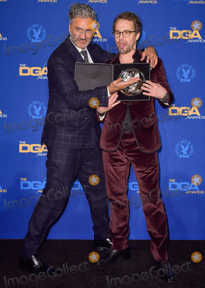 Sam Rockwell, Taika Waititi, RITZ CARLTON, The Ritz Photo - LOS ANGELES, CALIFORNIA, USA - JANUARY 25: Taika Waititi and Sam Rockwell pose in the press room at the 72nd Annual Directors Guild Of America Awards held at The Ritz-Carlton Hotel at L.A. Live on January 25, 2020 in Los Angeles, California, United States. (Photo by Image Press Agency)