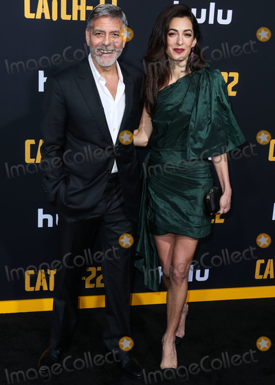 George Clooney, Oscar de la Renta, TCL Chinese Theatre, Amal Clooney, Amal Alamuddin Photo - HOLLYWOOD, LOS ANGELES, CALIFORNIA, USA - MAY 07: Actor George Clooney and wife/barrister Amal Alamuddin Clooney (wearing an Oscar de la Renta dress) arrive at the Los Angeles Premiere Of Hulu's 'Catch-22' held at the TCL Chinese Theatre IMAX on May 7, 2019 in Hollywood, Los Angeles, California, United States. (Photo by Xavier Collin/Image Press Agency)