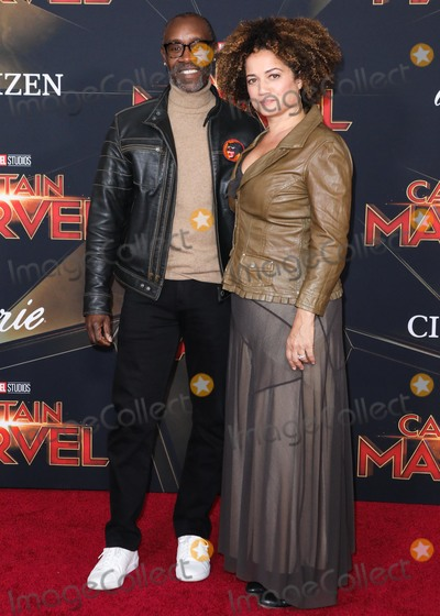 Bridgid Coulter, Don Cheadle Photo - HOLLYWOOD, LOS ANGELES, CA, USA - MARCH 04: Actor Don Cheadle and partner Bridgid Coulter arrive at the Los Angeles Premiere Of Marvel Studios 'Captain Marvel' held at the El Capitan Theatre on March 4, 2019 in Hollywood, Los Angeles, California, United States. (Photo by David Acosta/Image Press Agency)
