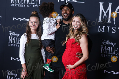 Stephen Boss, Allison Holker, Laurel Massé, MIGUEL BOSÉ Photo - HOLLYWOOD, LOS ANGELES, CALIFORNIA, USA - SEPTEMBER 30: Weslie Fowler, Maddox Laurel Boss, Stephen Boss and Allison Holker arrive at the World Premiere Of Disney's 'Maleficent: Mistress Of Evil' held at the El Capitan Theatre on September 30, 2019 in Hollywood, Los Angeles, California, United States. (Photo by Xavier Collin/Image Press Agency)
