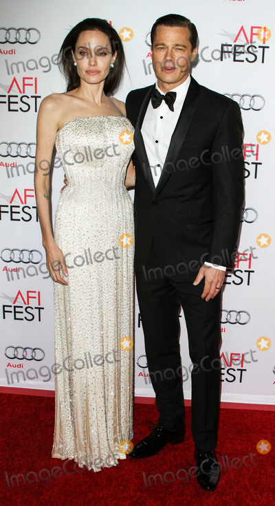 """Angelina Jolie, Audy, Brad Pitt, Jewel, ANGELINA JOLIE,, TCL Chinese Theatre Photo - (FILE) Angelina Jolie talks Brad Pitt divorce: """"I felt a deep and genuine sadness"""". HOLLYWOOD, LOS ANGELES, CALIFORNIA, USA - NOVEMBER 05: Actors Angelina Jolie Pitt (wearing an Atelier Versace gown and Procop jewels) and Brad Pitt (wearing Lanvin) arrive at the opening night gala premiere of Universal Pictures' 'By the Sea' during AFI FEST 2015 presented by Audi held at the TCL Chinese Theatre IMAX on November 5, 2015 in Hollywood, Los Angeles, California, United States. (Photo by Image Press Agency)"""