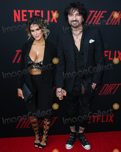 Tommy Lee, Brittany Furlan Photo - HOLLYWOOD, LOS ANGELES, CA, USA - MARCH 18: Brittany Furlan and husband/musician Tommy Lee arrive at the Los Angeles Premiere Of Netflix's 'The Dirt' held at ArcLight Cinemas Hollywood on March 18, 2019 in Hollywood, Los Angeles, California, United States. (Photo by Xavier Collin/Image Press Agency)