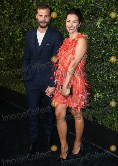 Amelia Warner, Cardigans, Jamie Dornan, Jamie Salé Photo - (FILE) Jamie Dornan and Wife Amelia Warner Are Expecting Their Third Child. Dornan and his wife are already parents to two daughters: Elva, 2, and Dulcie, who will celebrate her fifth birthday in November. BEVERLY HILLS, LOS ANGELES, CA, USA - MARCH 03: Actor Jamie Dornan wearing an Original Penguin cardigan and wife Amelia Warner arrive at the Charles Finch and Chanel Pre-Oscar Awards Dinner held at Madeo Restaurant on March 3, 2018 in Beverly Hills, Los Angeles, California, United States. (Photo by Xavier Collin/Image Press Agency)