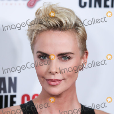 Charlize Theron Photo - (FILE) Charlize Theron Announces $1 Million Dollar Donation Amid Coronavirus COVID-19 Pandemic. Charlize Theron has donated $1 million dollars to the coronavirus relief efforts through her foundation, The Charlize Theron Africa Outreach Project and partners CARE and the Entertainment Industry Foundation (EIF). BEVERLY HILLS, LOS ANGELES, CALIFORNIA, USA - NOVEMBER 08: Actress Charlize Theron wearing Dior arrives at the 33rd American Cinematheque Award Presentation Honoring Charlize Theron held at The Beverly Hilton Hotel on November 8, 2019 in Beverly Hills, Los Angeles, California, United States. (Photo by Xavier Collin/Image Press Agency)