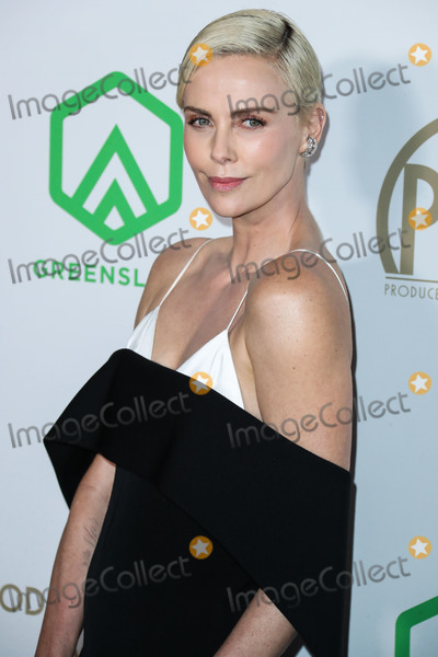 Charlize Theron, Givenchy Photo - (FILE) Charlize Theron Announces $1 Million Dollar Donation Amid Coronavirus COVID-19 Pandemic. Charlize Theron has donated $1 million dollars to the coronavirus relief efforts through her foundation, The Charlize Theron Africa Outreach Project and partners CARE and the Entertainment Industry Foundation (EIF). HOLLYWOOD, LOS ANGELES, CALIFORNIA, USA - JANUARY 18: Actress Charlize Theron wearing a Givenchy dress arrives at the 31st Annual Producers Guild Awards held at the Hollywood Palladium on January 18, 2020 in Hollywood, Los Angeles, California, United States. (Photo by Xavier Collin/Image Press Agency)